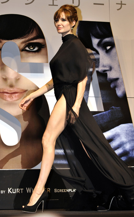"Angelina Jolie leaves the stage after greeting Japanese fans at the premiere of her latest film, the spy-thriller ""Salt"" in Tokyo on July 27, 2010. (Getty Images)"