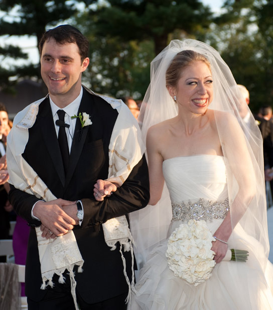 In this handout image provided by Genevieve de Manio, Chelsea Clinton (R) weds Marc Mezvinsky at the Astor Courts Estate on July 31, 2010 in Rhinebeck, New York.