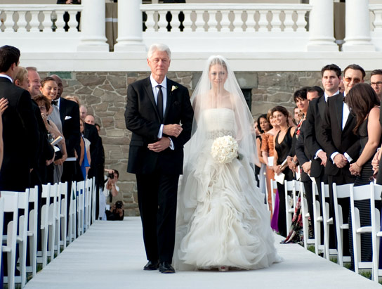 In this handout image provided by Genevieve de Manio, former U.S. President Bill Clinton (L) walks Chelsea Clinton down the aisle during her wedding to Marc Mezvinsky at the Astor Courts Estate on July 31, 2010 in Rhinebeck, New York.
