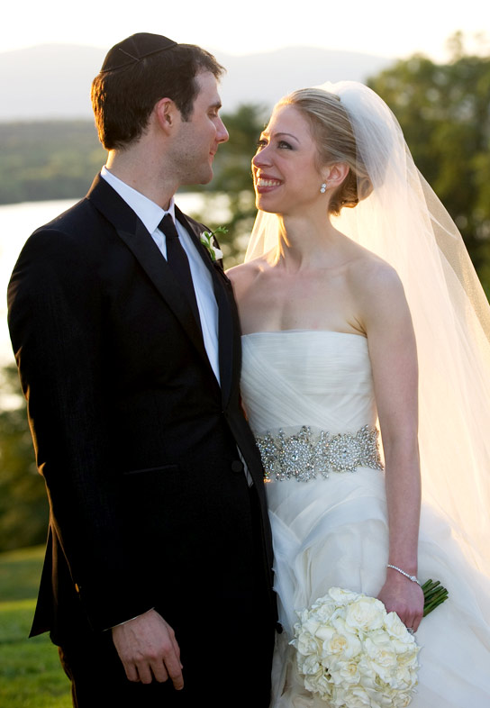 In this handout image provided by Barbara Kinney, Marc Mezvinsky (L) and Chelsea Clinton pose during their wedding at the Astor Courts Estate on July 31, 2010 in Rhinebeck, New York.