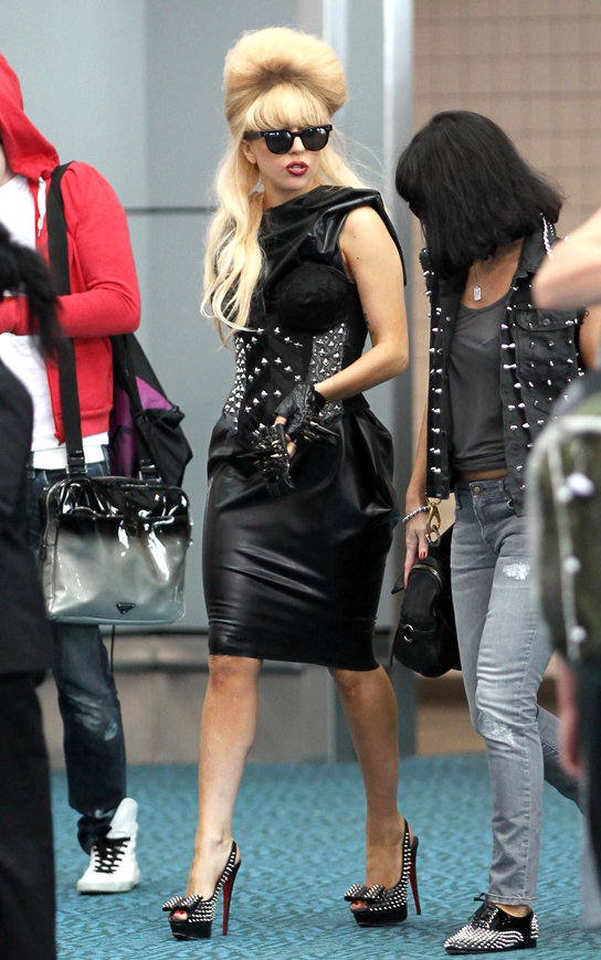 Lady Gaga arrives at Vancouver International Airport (YVR) in standout fashion as she prepares to catch a departing flight. The pop icon doesn't make things easy for herself as she makes her way through security wearing her metal-studded corset top, forcing an official to scan her with a metal detector. Once inside the terminal Gaga enjoys a Coke Zero. 8/26/10